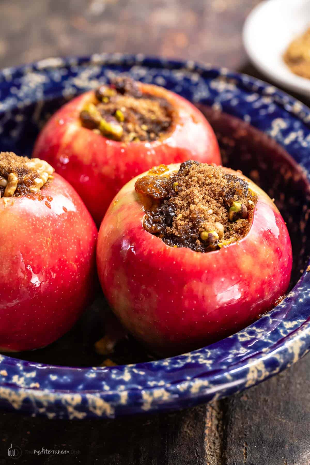 Side look at stuffed apples with cinnamon, brown sugar and nuts