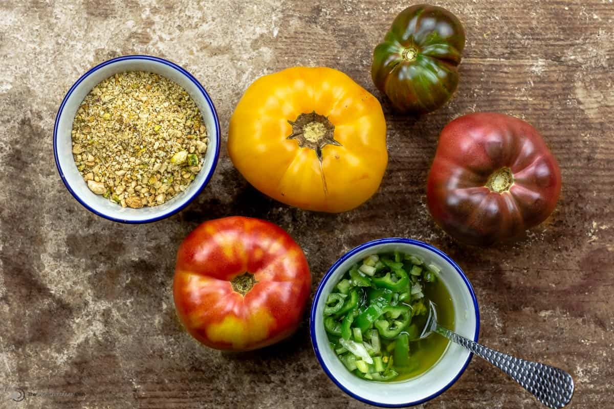 whole heirloom tomatoes with a side of dukkah nuts and jalapeno peppers