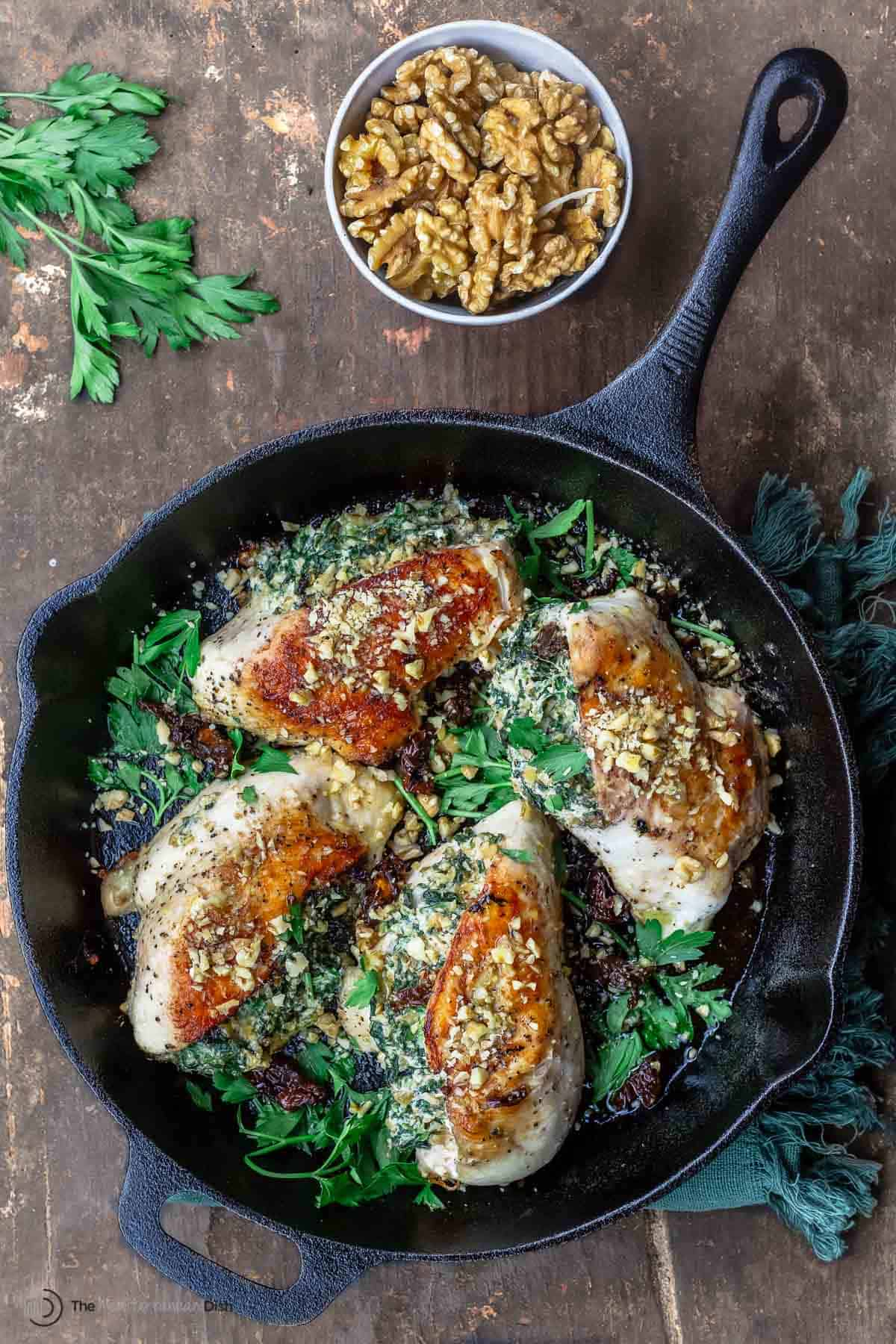 stuffed chicken breasts with a side of walnuts
