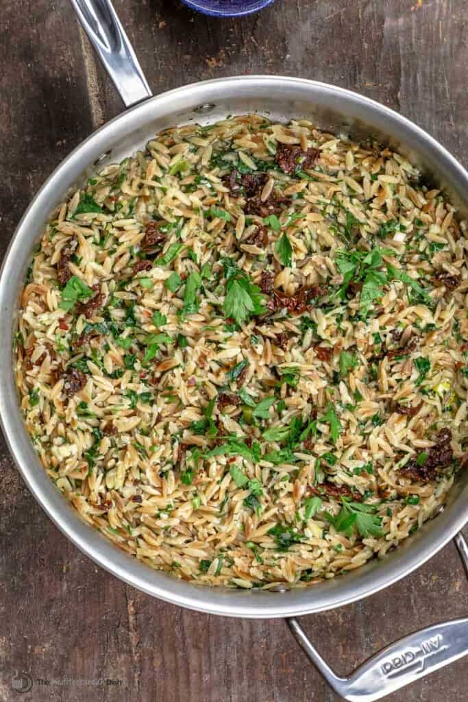 toasted orzo pasta with sundried tomatoes, parmesan, garlic and fresh herbs in one pan